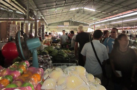 Ben's head of white hair makes him easy to track at Kudat market