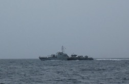The Malaysian navy appears out of the mist