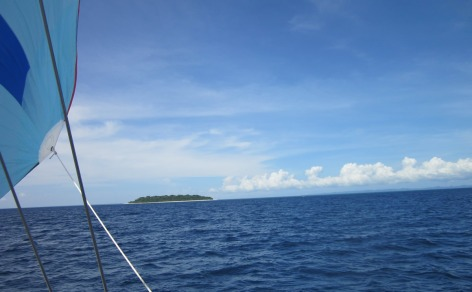 Scooting along past perfect tropical islands with the drifter up