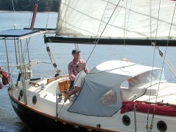 Hugh at the wheel of Longway on a daysail outing in Bateman's Bay