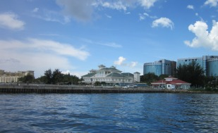 The defunct Labuan marina lies beyond the wall. The restaurant is in the red-roofed building to the right.