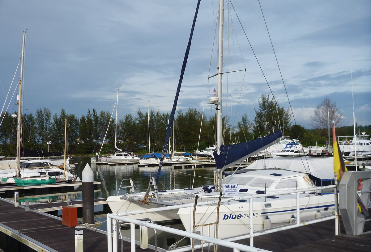 Candeux in the distance, tied up at Miri marina